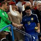 Golden Glove winner Germany's goalkeeper Manuel Neuer (L) congratulates Golden Ball winner...