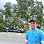 Gore farmer Matt Swney was counting his blessings after a massive gum tree fell on his truck,...