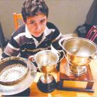 Gore High School pupil and golfer Sam Brinsdon (13), of Gore, with three of the trophies he has...