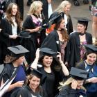 University of Otago graduands take part in a graduation parade along George St, Dunedin,...