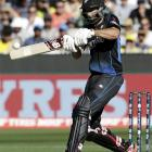 Grant Elliott hits a six during the Cricket World Cup final match against Australia at the MCG....