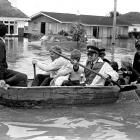 Grasmere  residents being rescued by rowing boat during Invercargill's big  flood of 1984.