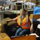 Green Island Landfill Recovery Store manager Kathy Abernethy reflects on some of the furniture...