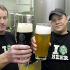 Green Man sales manager Tom Jones (left) and brewer Enrico Gritzner compare a couple of the...