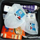 1.Milk containers sit in a blue bin waiting to be picked up by Dunedin City Council recycling...