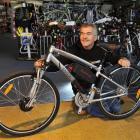 Greg Leov of Bike Otago in Dunedin with a mountain bike converted into an electric bike in 2011....