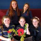 Tahuna Intermediate pupils check progress on one of the 100 poppy seedlings they are  growing ...
