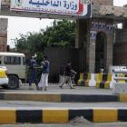 Guards are seen at the gate of the Interior Ministry's headquarters in Sanaa. REUTERS/Khaled...