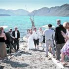 Guests wish Catherine Lyness and Nigel Anderson well after they were married on a Lake Wanaka...