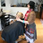Hairdresser Holly Pemberton (right), of Roxburgh, gets into the Scottish spirit with client (left...