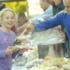 Forbury School (Dunedin) pupil Barbie Taylor (10) is served vegetables and meat by school...