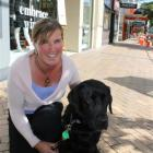 Hannah Pascoe and her guide dog Coral. Photo by Allison Beckham.