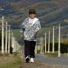 Harrison Kemp steps out on Maungatua Rd near Outram in preparation for his 10km trek in the area...