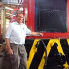 Harry Andrew with the diesel locomotive he has restored. Photo by Sally Rae.