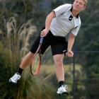 Harry James practises his serve at the John McGlashan courts. Photo by Peter McIntosh.