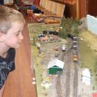 Hayden Benfell (6), of Bannockburn, takes a closer look at Malcolm Cotter's model of the railway...