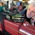 Hayward's Auction House auctioneer Kevin Hayward, of Dunedin, inspects a hand-built live steam...