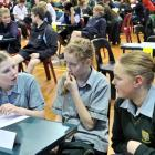 Heads together  ...   Bayfield High School pupils (from left) Hannah McGregor, Neive Nicholas and...