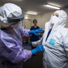 Healthcare professionals at Auckland City Hospital train for possible treatment of an Ebola...