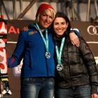Heather Mills of Great Britain and Melanie Schwartzc of the USA pose on the podium after their...
