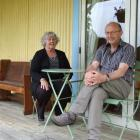 Helen and Stephen Packer on the deck of their Bannockburn crib. The veranda was added as part of...