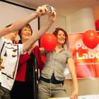 Helen Clark poses for a photograph with two students at the University of Otago common room...
