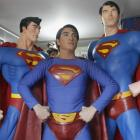 Herbert Chavez poses with his life-sized Superman statues inside his house in Calamba Laguna,...