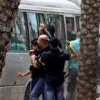 Hezbollah supporters attack a bus carrying anti-Hezbollah protesters in front of the Iranian...
