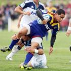 Highlander Aaron Smith in the tackle of Chris Smylie in the preseason Investec Super rugby match...