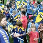 Highlanders captain Jamie Mackintosh with flag-waving young fans. Photos by Matt Stewart.