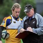 Highlanders captain Jimmy Cowan and scrum coach Mike Cron discuss tactics at Logan Park this week...