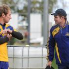 Highlanders coach Glenn Moore (right) talks tactics with captain Jimmy Cowan at training at Logan...