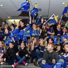 Highlanders fans provide a welcoming sea of colour to greet  their team at Dunedin International...