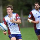 Highlanders first five-eighth Colin Slade back in training at Logan Park yesterday. Photo by...