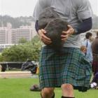 Highlanders fitness trainer Matt Dallow competes in the Carrying the Stones, in which he was...