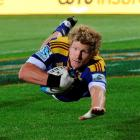 Highlanders flanker Adam Thomson scores the first of his two tries against the Cheetahs during...