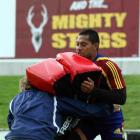 Highlanders flanker Alando Soakai holds a tackle bag at Rugby Park in Invercargill yesterday....