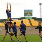 Highlanders going through a line-out routine at Carisbrook yesterday are (from left) Jamie...