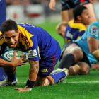 Highlanders halfback Aaron Smith scores a try during his team's round three Super 15 match...