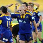 Highlanders hooker Jason Rutledge celebrates with his team mates after their 14-9 win over the...