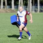 Highlanders hooker Jason Rutledge gets the legs pumping at training at Logan Park this week....