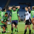 Highlanders Lima Sopoaga (left) and Jamie Mackintosh wear their green jerseys during a Super 15...
