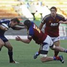 Highlanders lock Tom Donnelly, right, tackles South Africa's Stormers Peter Grant, left, during...