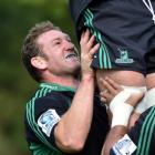 Highlanders prop Chris King lifts a team-mate at training at Logan Park this week. Photo by Peter...