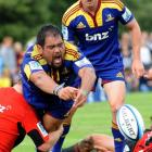 Highlanders prop David Te Moana screams in anguish after dropping the ball in the tackle while...