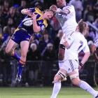 Highlanders wing Ben Smith grabs at a high ball ahead of Stormers counterpart Gcobani Bobo in...