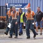 Hillside workers leave a meeting with KiwiRail chief executive Jim Quinn, who yesterday announced...