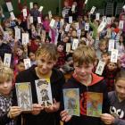 Holding the colourful cutout All Blacks they have coloured in to be sent to schools in Argentina,...