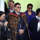 Hone Harawira, dressed in a feather cloak (korowai), is welcomed on to Rawhitiroa kura kaupapa...