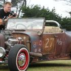 Hot rod enthusiast Colin Gale, of Dunedin, takes a photo of a '27 Roadster at Stateside Streeters...